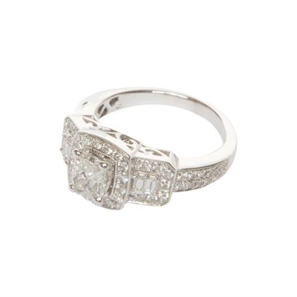 Vintage diamond ring with four stone trilliant cut diamond centre