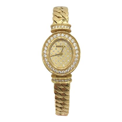 Rolex gold oval diamond set face ladies vintage watch