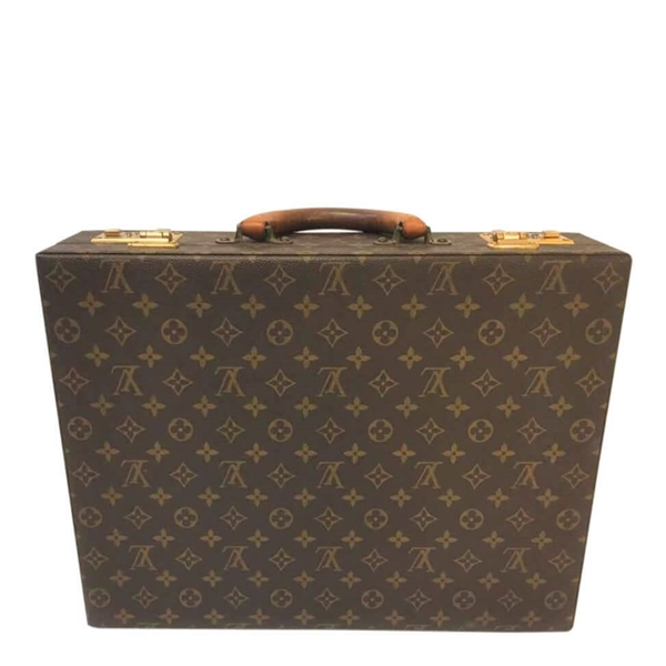 Picture of Louis Vuitton Attaché Is A Hard Small Suitcase With Inside Compartments And A Number Lock