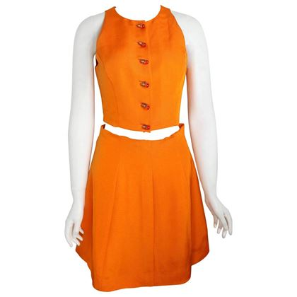 chloe-orange-cropped-vest-and-skirt-ensemble-with-light-bulb-buttons