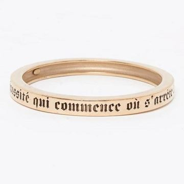 Chanel 'Luxury Is A Necessity' Gold Tone Bangle