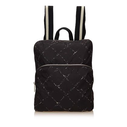 chanel-black-and-white-quilted-printed-travel-line-backpack