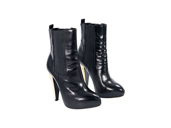 black-moschino-leather-chelsea-ankle-boots-75-black