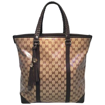 gucci-coated-monogram-and-brown-braided-leather-trim-tassel-tote-2
