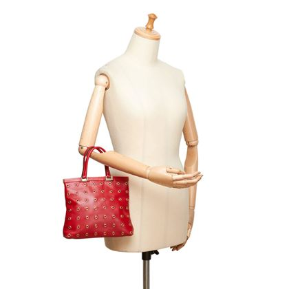 prada-red-calf-leather-18-carat-gold-toned-eyelet-handbag