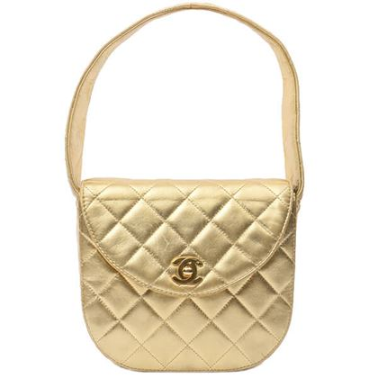 chanel-round-turn-lock-handbag-gold