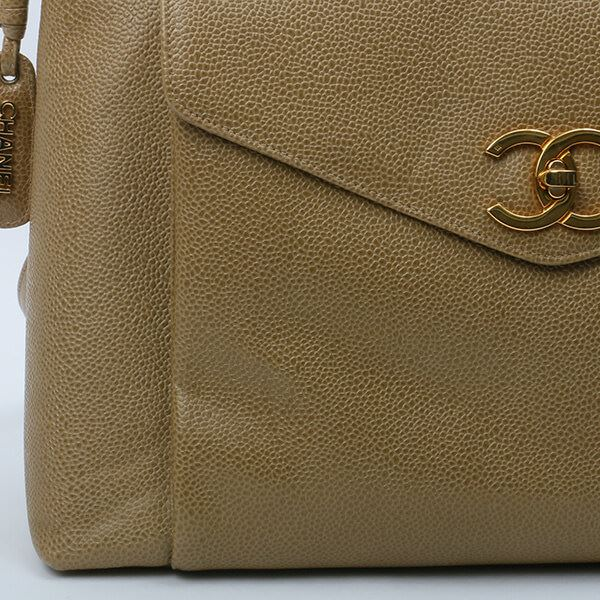 chanel-caviar-leather-turn-lock-logo-charm-tote-bag-beige