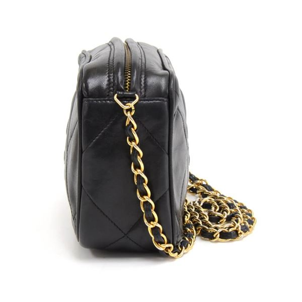 vintage-chanel-black-quilted-lambskin-leather-tassel-pochette-shoulder-bag