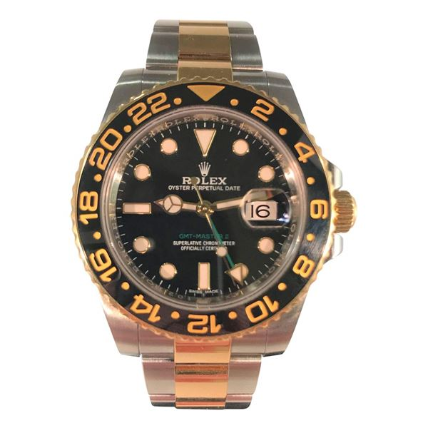Picture of Rolex GMT Master II featuring Black and Gold Bezel