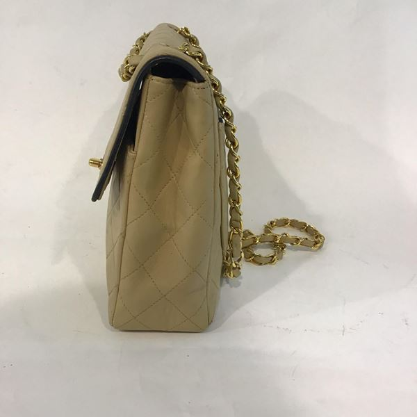 chanel-classic-flap-bag-in-beige-leather-with-gold-hardware