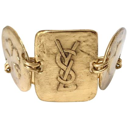 yves-saint-laurent-ysl-1980s-vintage-gold-plated-cuff-bracelet-with-logo