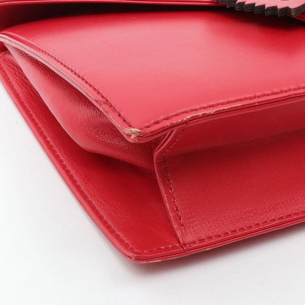 yves-saint-laurent-ribbon-clutch-bag-red