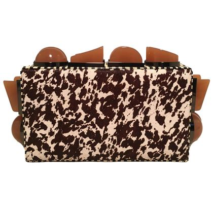 tonya-hawkes-brown-and-white-cow-print-pony-hair-clutch-with-tan-acrylic-studs