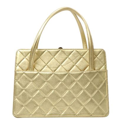 chanel-cc-mark-metal-clasp-handbag-gold