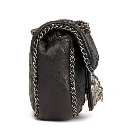 black-quilted-aged-calfskin-leather-lion-chain-around-mini-flap-bag