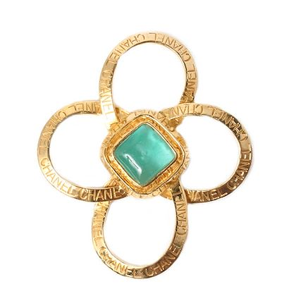 chanel-clear-glass-flower-motif-logo-brooch-light-green