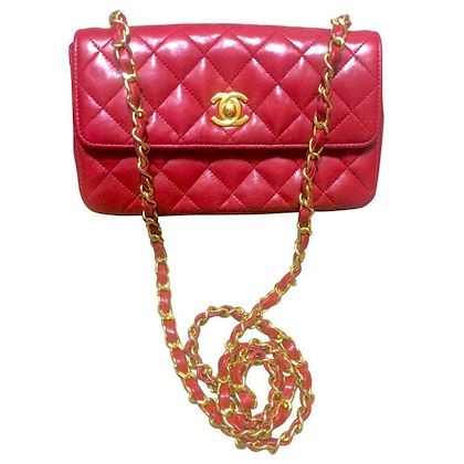 vintage-chanel-classic-mini-flap-255-shoulder-bag-in-lipstick-red-lambskin-with-golden-cc-and-chain-strap-popular-purse-back-in-the-era