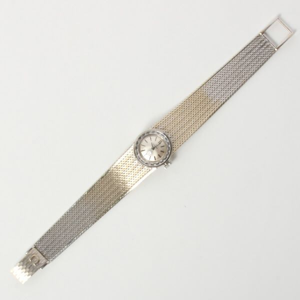 omega-round-cut-glass-face-watch-silver