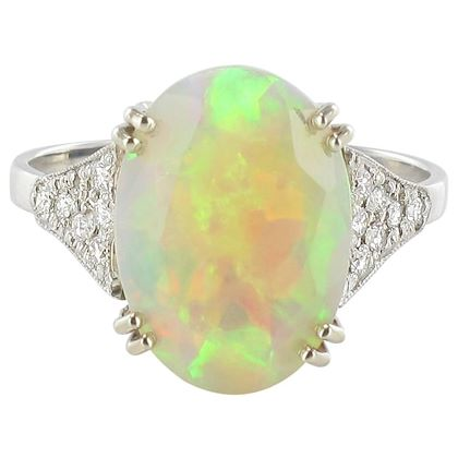 faceted-opal-diamond-gold-ring
