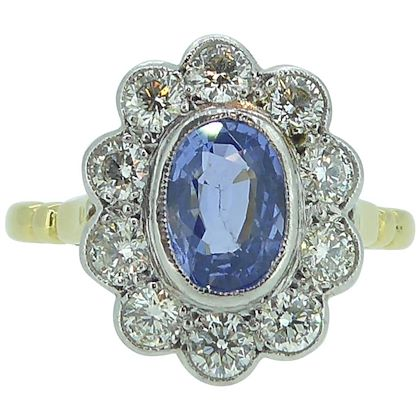 vintage-sapphire-and-diamond-engagement-ring-cluster-style-in-18-carat-gold