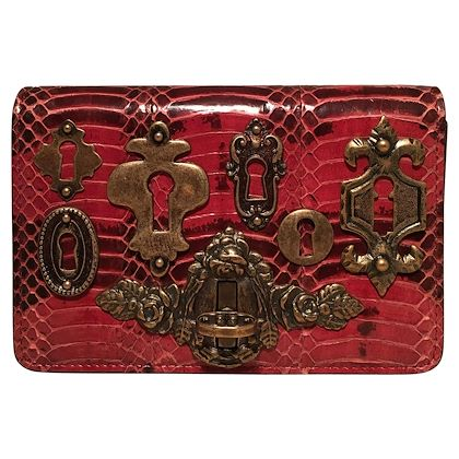 dolce-and-gabbana-maroon-snakeskin-keyhole-clutch-bag