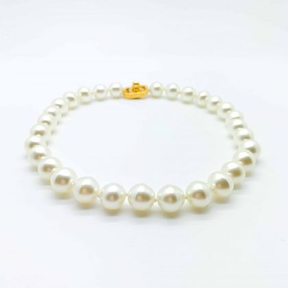 vintage-chanel-pearl-necklace-with-turnlock-clasp-1996