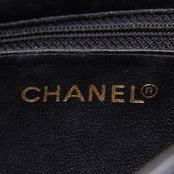 chanel-patent-leather-drawstring-backpack