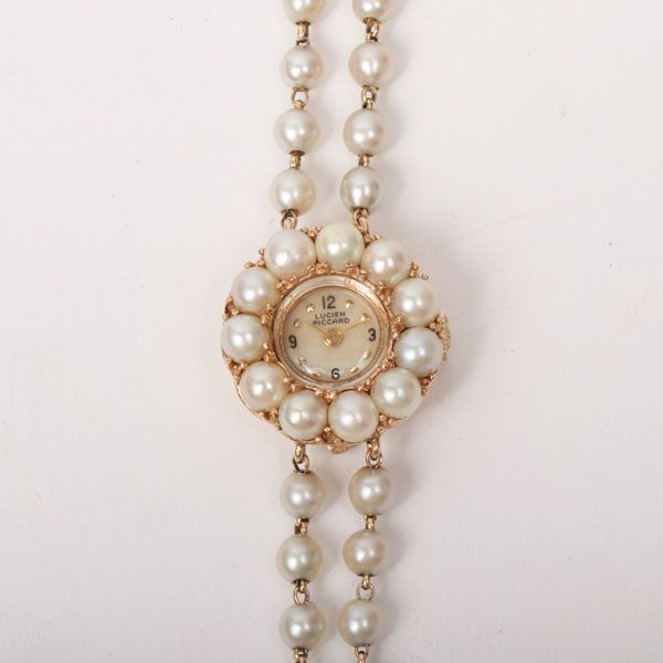 lucien-piccard-pearl-shell-watch-gold