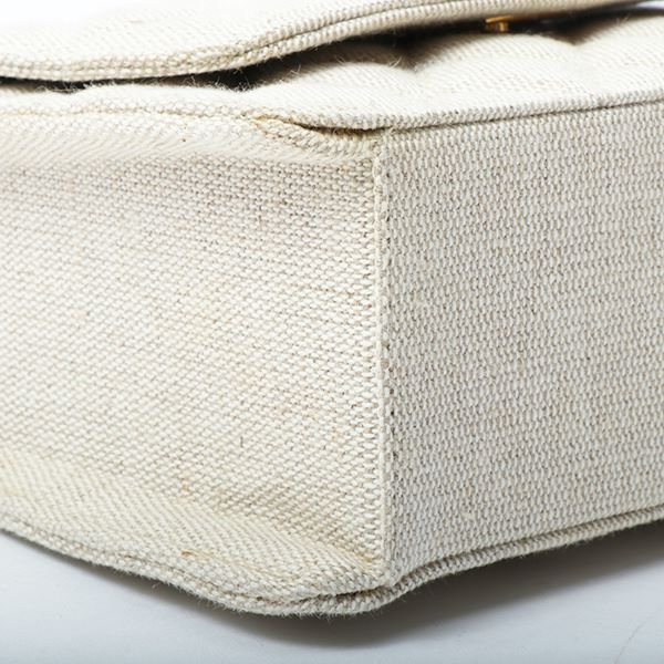 chanel-cotton-turn-lock-handbag-beige