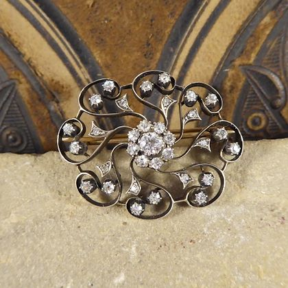 late-victorian-110-carat-total-diamond-flower-cluster-brooch-in-gold-and-silver