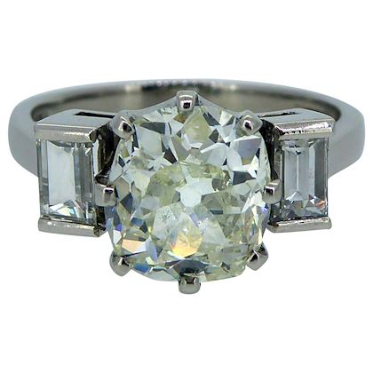 252-carat-old-european-cut-diamond-052-carat-baguette-diamond-3-stone-ring